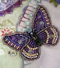 I ❤️ crazy quilting . . . and the beading on this butterfly- Allie's in Stitches: crazy quilt blocks