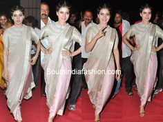"Actress Samantha attended ""Alludu Seenu"" music launch event in pale pink and silver color combination Anamika Khanna dhoti saree teamed up with silver high neck corset blouse"