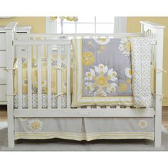 If you are looking for a uniquely beautiful crib ensemble for your little girl's nursery, Michele Adams and Gia Russo have created this one just for you. The cheerful yet crisp color scheme is a refreshing departure from the standard pinks and pastels. Various textures including suede and corduroy complement the comfort of pure cotton. The white, fitted crib sheet is printed with a beautiful yellow, gray, and white floral pattern. #timelesstreasure