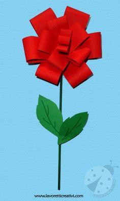 Una rosa facile da realizzare con cartoncini colorati e un bastoncino di legno. Idea da tenere presente come lavoretto per la Primavera e per la Festa dell