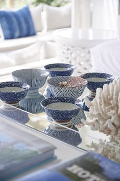 High on the mountainside overlooking Plettenberg Bay lagoon, Indigo House commands a spectacular view and boasts signature indigo, white and wood interiors. Outdoor Living Furniture, Wood Interiors, Table Arrangements, Coastal Living, Bold Colors, South Africa, Decorative Bowls, Indigo, Blue And White