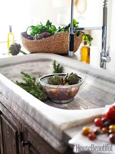 Vintage marble sink and a contemporary, industrial faucet. (That sink is 56 inches long!)