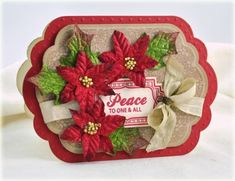 Christmas Cards are fun to make with Velvet Pointsettias and leaves from Petaloo! Cut and emboss some Christmas cardstock, add Petaloo flowers along with a message and you have a card you will be proud to give away...