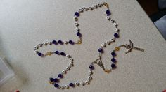 A mother ordered a rosary for her son serving in the United States Navy.  She added the names of his family members. (#'s 503/415)