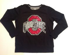 Womens Black Ohio State University (OSU) Rhinestone Sweatshirt in Size Large.   Gorgeous bling, really stands out against the black sweatshirt!  Sweatshirt is nicely made, fleece lined and has the thumb holes in sleeve cuffs.  Each piece I make is unique and original either by logo/design or by sty