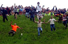 The Gloucester Cheese Roll, where locals try and catch cheese rolling down Cooper's Hill. a 200 year long tradition. Gloucester, #England