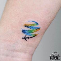 Brush stroke travel tattoo by Deborah Genchi