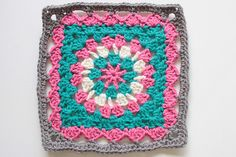 """Pattern: Improvised by me Hook used: H Yarn Used: Hobby Lobby's I Love this Yarn in Grey Beard, Hot Rose, Peacock and Ivory. Finished size: 8"""" This square came about because a friend asked a question about crocheting circles. Then I started creating different types of variations on the plain..."""
