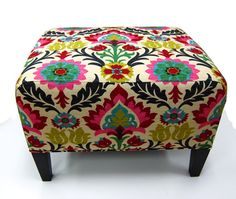I love this ottoman! Found it via the fabric: Modern Ikat Fabric