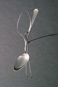 "Haley Bates -- ""Excised""; Sterling silver, steel; 7-1/2"" x 1-1/2"" x 2"", 2005"