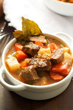 This Healthier Slow Cooker Beef Stew is a very simple, but yet hearty slow cooker stew with potatoes, carrots, turnips, parsnip and herbs.
