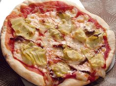 This pizza is a mix of milk, olive oil, and beer� which gives the dough a unique taste.