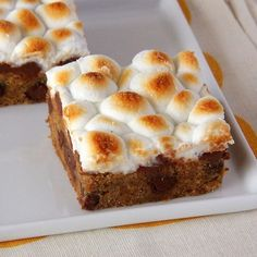 These graham cracker-infused cookie bars are topped with a melty marshmallow layer.
