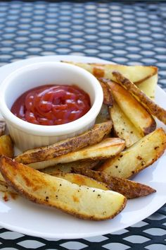 These oven fries are crispy and salty, thick but not stodgy, and you don't even have to peel the potatoes, which probably makes them health food!