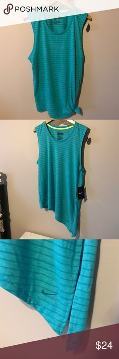 Nike dri fit side tie!! From the Nike club tee collection - ❤️❤️❤️ this top! Can be worn asymmetrical but made to wear tied on side, adorbs! Color is teal striped and material is that of a tshirt type. S/M is how it's sized Nike Tops