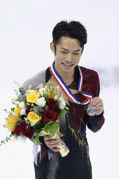 Daisuke Takahashi Photos Photos - Men silver medalist Daisuke Takahashi of Japan poses for photo during the medal ceremony of Cup of China ISU Grand Prix of Figure Skating 2012 at the Oriental Sports Center on November 3, 2012 in Shanghai, China. - ISU Grand Prix Of Figure Skating 2012/2013 Lexus Cup Of China - Day 2