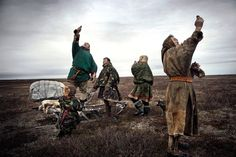 A family of Nenet nomads try to acquire mobile phone signals in October, 2009.     [Credit : Yuri Kozyrev]