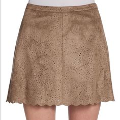 Like new bcbg maxazria suede scalloped skirt Lovely laser cut bcbg taupe suede skirt with a scalloped accent! Perfect for the transitional season! BCBGMaxAzria Skirts Mini