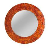 Found it at Wayfair - Cameron Mirror insilver not orange but is out of stock till 10/04.  24 inches in diameter