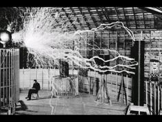 Nikola Tesla sitting in his laboratory with his Magnifying Transmitter-this picture is amazing!