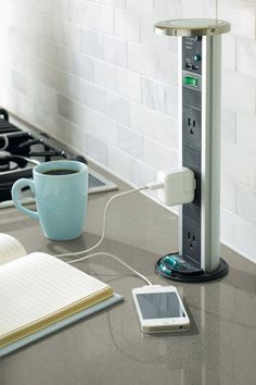 Power Pod | With a gentle pull, this Power Pod electrical source brings power to counter areas, featuring three electrical sockets and two USB ports.