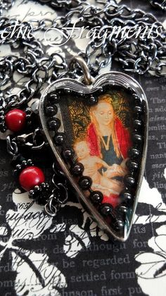 BLESSED Our Lady Heart Charm Necklace. Vintage Red Christmas Postage Stamp. A Little Bohemian. A Little Goth. Mixed Media Assemblage No.1
