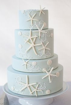 Brides.com: Beach-Themed Wedding Cakes. A Pale Blue Wedding Cake with Starfish. If you're marrying by the water, consider this elegant confection by pastry chef BethAnn Goldberg of Studio Cake in Menlo Park, CA. Inspired by the serenity of the ocean, BethAnn covered the four cake tiers in pale-blue fondant and then decorated the tiers with starfish molded from fondant and piped icing to mimic waves. The varying tier heights add visual interest and the overall look is as calm and serene as…