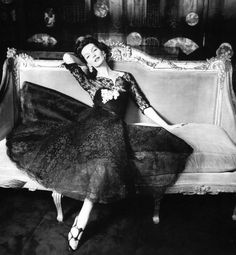 Joanna McCormick in a lace dress by Chanel at Mademoiselle's apartment, photographed by Henry Clarke, 1957
