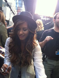 love her hair...waves + the hat = adorable combo!
