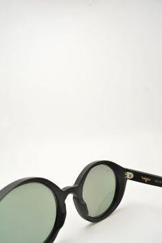 Logos ANDREA black matte sunglasses #sunglasses #logos #roundshape #blackmatte #lightblue #mirroredlens #bassanodelgrappa #designglasses #design #cheap online store at www.bassanooptical.com