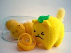 Lemon the Bitter Kitty Plush -- adorable little yellow cat, bitter handsewn face, with glass bead eyes and faux fur tail. So cute!    Available at plushimi.etsy.com