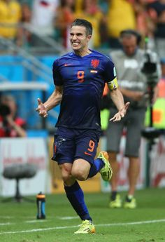 Spain v Netherlands: Group B - 2014 FIFA World Cup Brazil - SALVADOR, BRAZIL - JUNE 13: Robin van Persie of the Netherlands celebrates his teams first goal in the first half during the 2014 FIFA World Cup Brazil Group B match between Spain and Netherlands at Arena Fonte Nova on June 13, 2014 in Salvador, Brazil. (Photo by Paul Gilham/Getty Images)