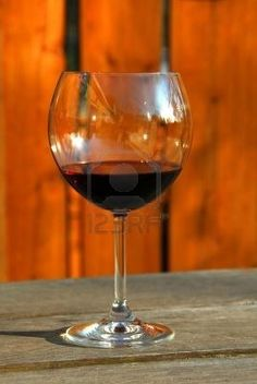 Glass of red wine on old rustic table, vertical Stock Photo