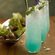 Recipe of the Day: Blue Thai Mojito - Makes: 1 drink  Ingredients 1/4 ounce blue Curaçao  1 1/2 ounces Bacardi Limon rum or Bacardi white rum 1 1/2 ounces Coco-Mint Syrup (recipe follows) 1 ounce fresh lime juice 2 ounces chilled soda water  For garnishing Fresh mint and/or cilantro sprigs Shaved coconut (optional)  Preparation Fill a tall glass with ice. Measure in the Curaçao, rum, syrup, lime juice, and soda water. Stir with a bar spoon. Garnish with fresh mint and/or cilantro and a…