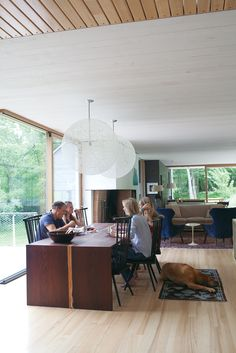 Architect Alan Organschi inherited chairs from his uncle that he and his partner and wife, Lisa Gray, use with the custom wenge-wood dining table in their weekend getaway in Washington, Connecticut. Photo by Andrea Chu.