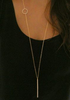 Add a subtle shine to your outfit by donning this gold circle and bar long necklace.