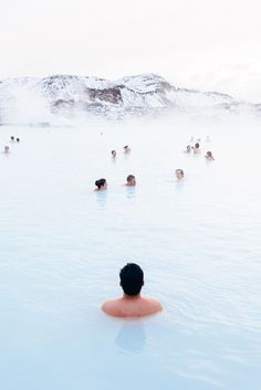 The Blue Lagoon hot springs in Iceland: a man-made lagoon supplied by water from…