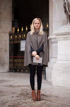 Not sure I get the peep-toe booties, but her cape is cute