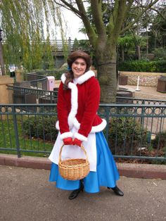 Belle wearing her Christmas outfit at Disneyland Paris