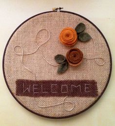 sewing hoop with felt flowers, burlap and twine