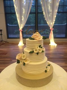 texture horizontal buttercream with custom love topper and fresh floral