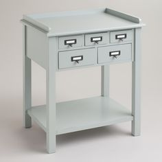 Gray 5-Drawer Preston Table | World Market.  drill holes in the back and have each top drawer a charging station for the kids phones, etc.  bottom drawers for pencils, crayons. and scout books. charge my laptop on top. basket for library books on bottom.  PERFECT!