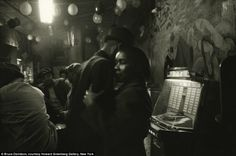 Private moment: Alongside photos depicting injustice and hardship there are images capturing joyous moments like dancing in a club to the sounds of a jukebox
