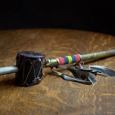 Artist: Carlos Longoria - Navajo - Native American rattles and shakers may be used as a dance rattle or to accompany the rhythm of the Native Indian drums. This rattle is hand-made with rawhide with leather and beads around the handle. #nativeamerican #navajo #rattle #dancerattle #rhythm #beadwork #drum #handcrafted #handmade #aktalakotamuseum #music #powwow