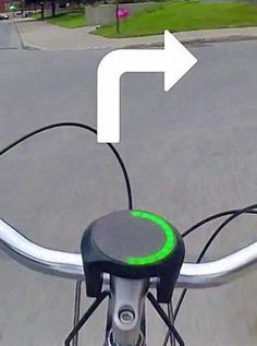 """The """"SmartHalo"""" attaches to the handlebars of any normal bicycle and, once paired with your smartphone, acts as a visual navigation guide, complete with turn-by-turn signaling. Now if only I rode a bicycle. Electronics Gadgets, Tech Gadgets, Cool Gadgets, Cool Technology, Technology Gadgets, Technology Gifts, Mobiles, Smartphone, Wireless Security Cameras"""
