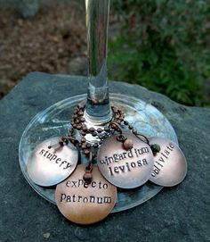 Hand-stamped Harry Potter wine charms. OMG!