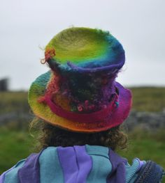 The Rainbow Helix is a hand felted wool top hat. An original design from Innerspiral Studio, it is crafted each time in a bespoke manner with our hand dyed wools.  This hat glories in its dimensions of texture and colour, created with layers of wools blended by hand into batts, decorated with hand dyed fleece curls and sparkle firestar in every shade of the rainbow.  We use organic wools where possible and source fleece from local farms where the animals are well treated naturally.  The…