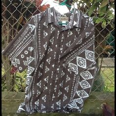 Tribal Print Aloha Shirt Men's made in Hawaii Aloha Shirt. Tribal print, front buttoned down shirt, with front chest pocket. Gently used and in great condition. Perfect for Fathers Day. Blue Hawaii Tops