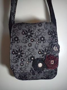 A custom purse with a little added bling. Love the ribbon flowers.