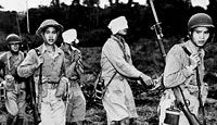 Chinese soldiers lead blindfolded Japanese prisoners away from the front after their capture in Burma.